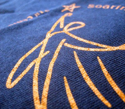 Close up of Screen printed custom t-shirts for Boston summer camp HAPHI